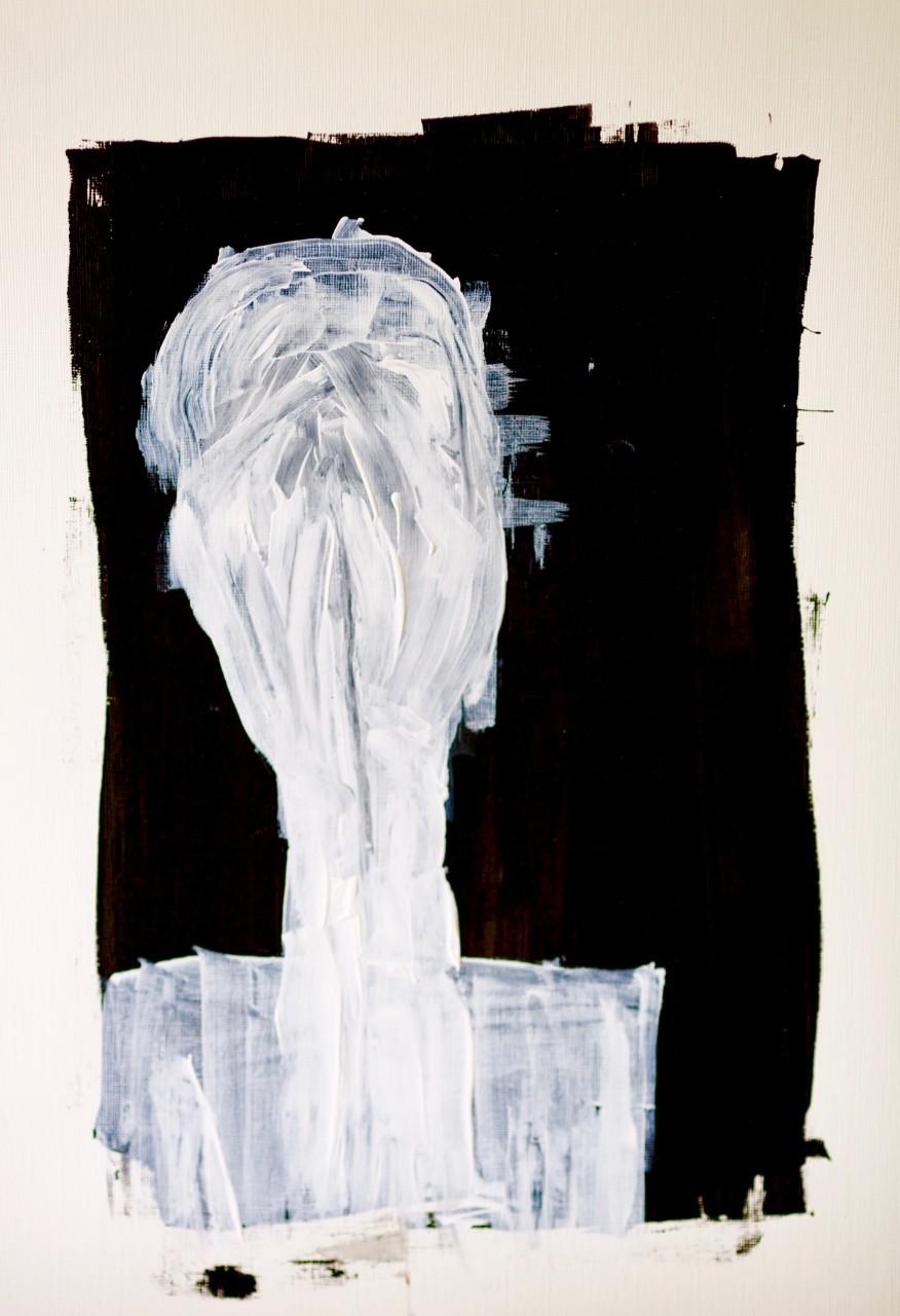 human figure head held in her / his hands